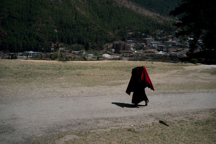 Bhutan, the world's only carbon negative country is also a traveler's paradise- from the mountains to the serene monasteries, it is culturally and naturally gifted. The Traveler - 2018 EyeEm Awards Travel Travel Photography Bhutan Color Monks Travel Destinations My Best Travel Photo A New Beginning