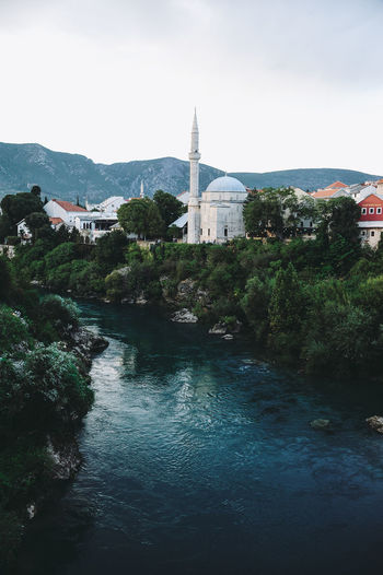 BIH Bosnia And Herzegovina Mostar Architecture Beauty In Nature Bosnia Building Exterior Built Structure Day History Nature No People Outdoors Place Of Worship Religion River Sky Spirituality Travel Destinations Tree Water