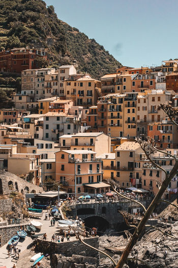 Village conforming to the natural shape of the cliff. Architecture Built Structure Building Crowded Day Water High Angle View Nature Mountain TOWNSCAPE Outdoors Community Village Village Life Italia Italy Traveling Travel Destinations Travel Photography Travel Liguria Manarola Cinque Terre Europe Photography