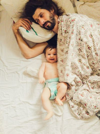 happy baby and tired daddy Happy Looking At Camera Smiling Toddler  Morning Waking Up Parenthood EyeEm Selects Baby Childhood Young Furniture Child Bed Togetherness Real People Indoors  Innocence Babyhood Lying Down Full Length High Angle View Sleeping Bedroom Bonding Positive Emotion