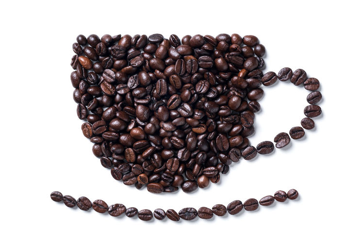 Directly above shot of coffee beans on white background