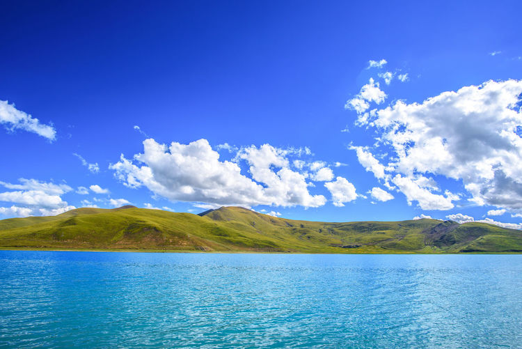 High Altitude lake in Tibet Beauty In Nature Blue Cloud - Sky Day Environment Lake Land Landscape Mountain Mountain Range Nature No People Outdoors Purity Scenics - Nature Sky Tranquil Scene Tranquility Travel Destinations Water