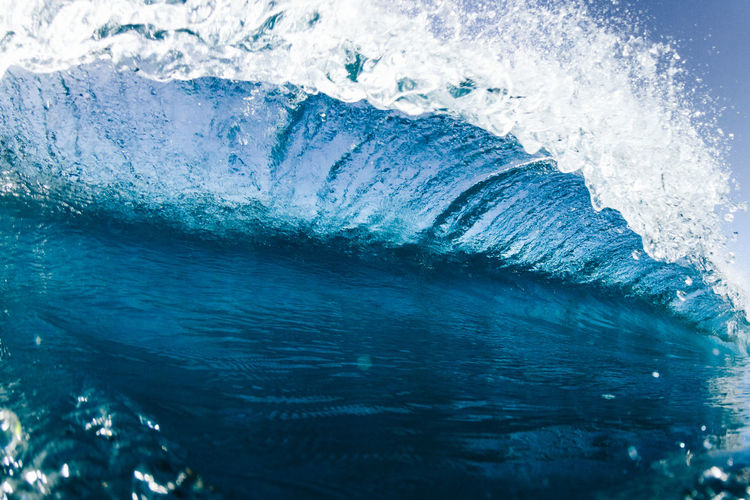 Close-up of sea waves against blue sky
