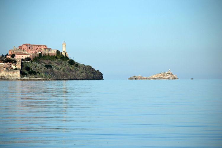 Island Of Elba By Sea Against Clear Sky