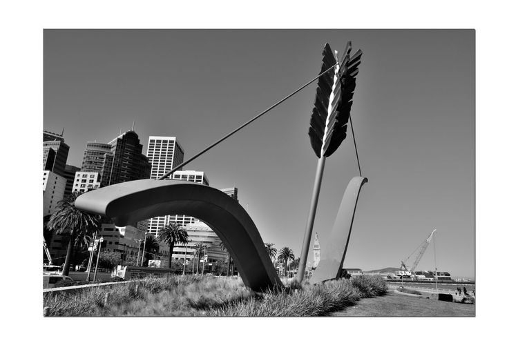 Cupid's Span 2 San Francisco CA🇺🇸 Rincon Park The Embarcadero Cupid's Span 60 Ft. Outdoor Sculpture 2002 Bnw_from_beneath Bnw_friday_eyeemchallenge Drawn Bow & Arrow Partial Bow & Piece Of An Arrow Love's Weapon Of Choice Implanted In The Ground Ferry Building Skyscrapers Construction Crane Monochrome_Photography Monochrome Black & White Black & White Photography Black And White Black And White Collection  Sculptors: Oldenburg & Bruggen San Francisco Bay Waterfront♥ Home Port Of Eros Public Art Cityscape