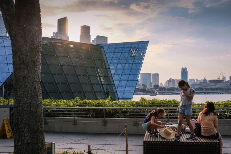 A family spending a leisure time in Singapore. Family In Singapore, Louis Vuitton Marina Bay Sands Fun Time In Singapore Architecture Marina Bay Sands Marina Bay Sands Architectur Family Time Singapore Lifestyle In Singap