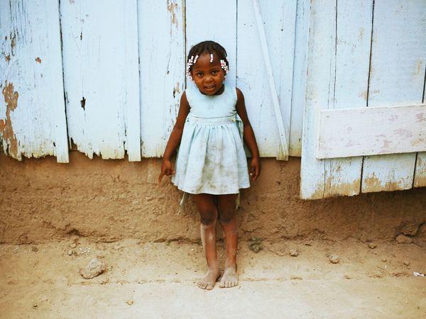 A little girl who matched the chapel wall Dominican Republic La Romana Batey Fashion
