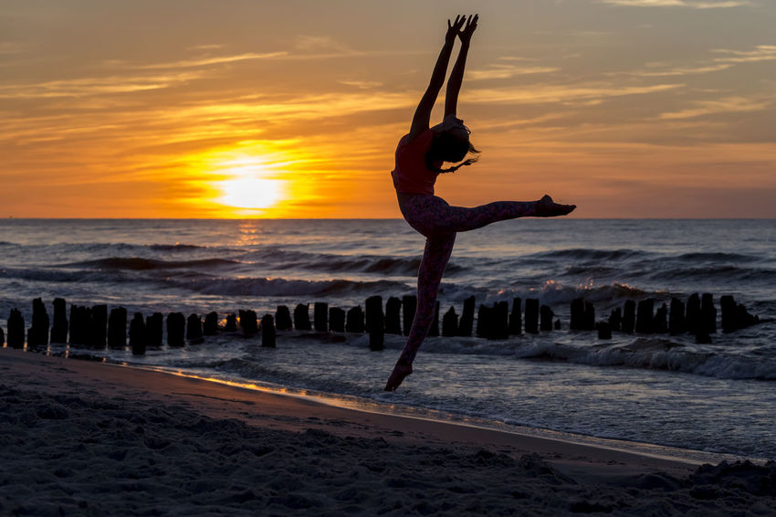 Ballerina Balance Ballet Dancer Ballett Beach Beauty In Nature Full Length Horizon Over Water Leisure Activity Lifestyles Motion Nature One Person Outdoors Real People Sand Scenics Sea Silhouette Sky Sunset Water Paint The Town Yellow