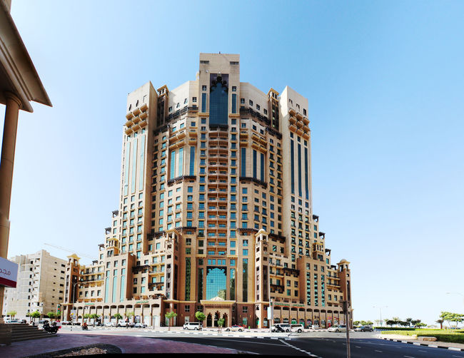 Architecture Blue Building Building Exterior Built Structure City City Life Clear Sky Day Diminishing Perspective Dubai Exterior Low Angle View Modern No People Outdoors Residential Building Sky Sunlight Sunny Tall - High