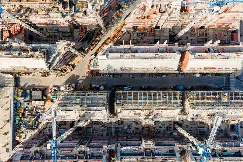 Aerial view of an enormous construction site along tagus riverside in lisbon city center, portugal.