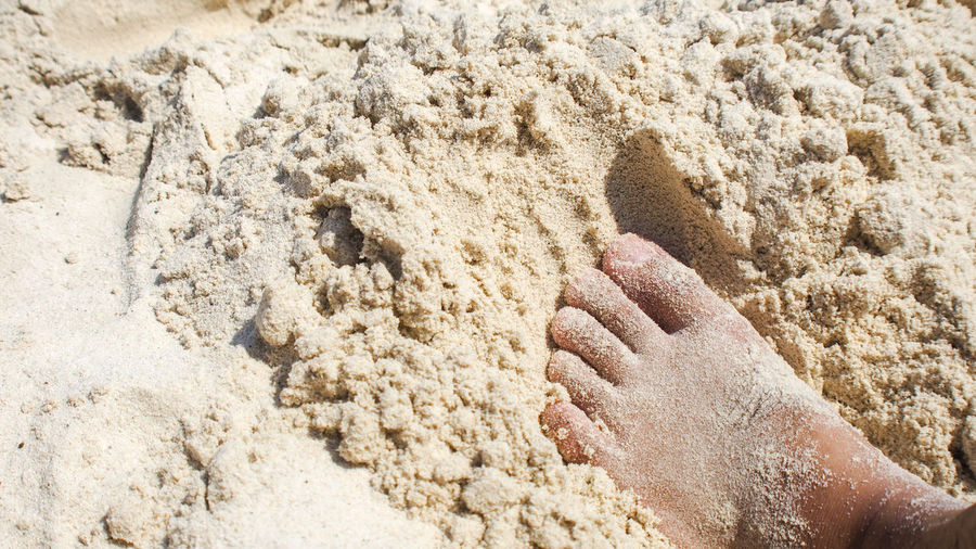 High Angle View Of Foot In Sand