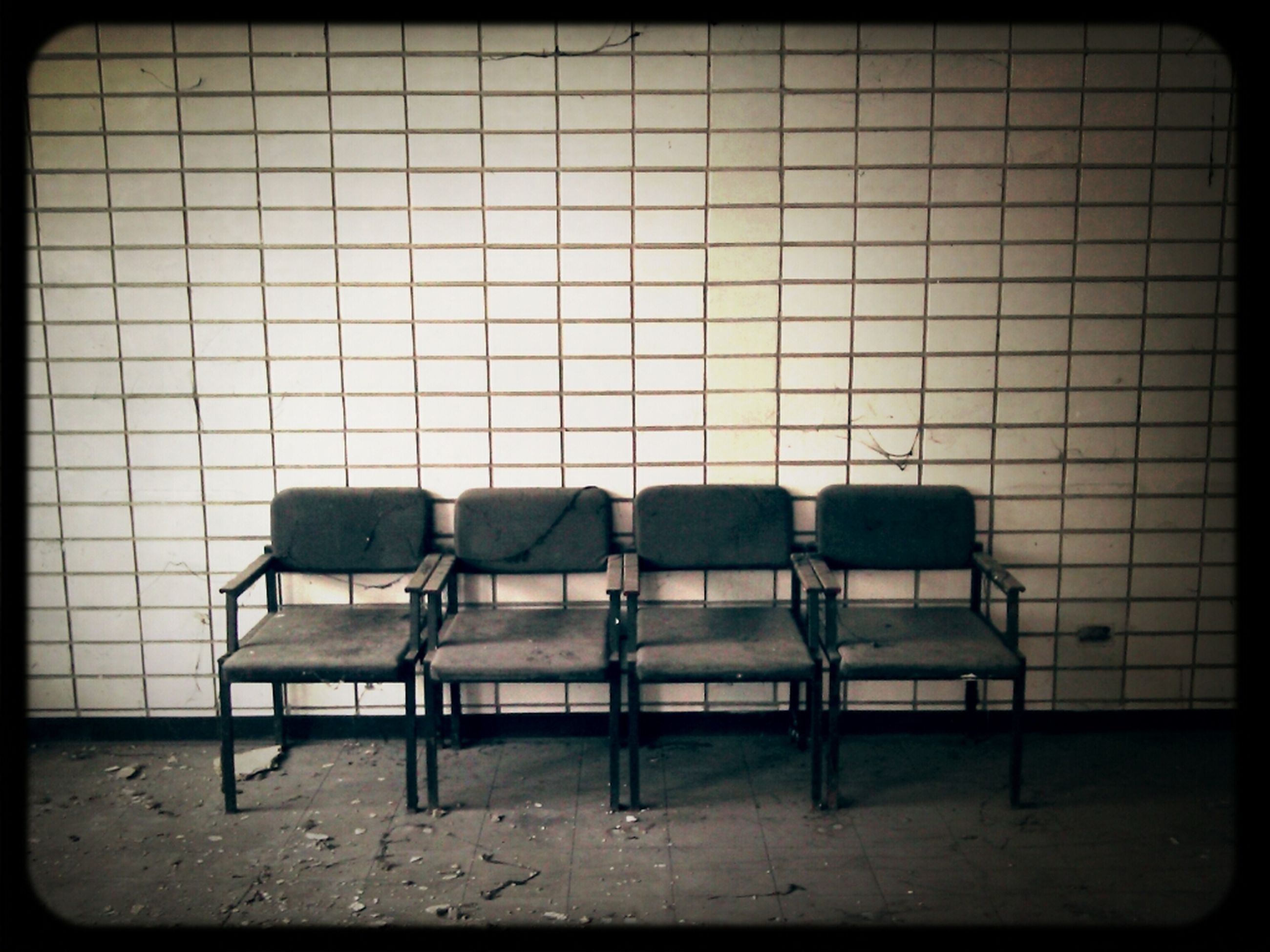 chair, transfer print, indoors, empty, auto post production filter, absence, seat, window, table, built structure, furniture, architecture, day, no people, sunlight, bench, sofa, abandoned, wall - building feature, side by side