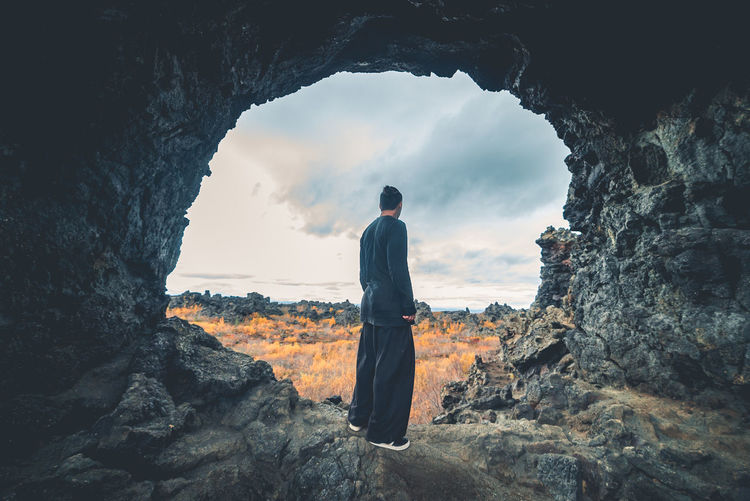 Beauty In Nature Day Full Length Leisure Activity Lifestyles Men Nature One Person Outdoors People Real People Rear View Rock - Object Rock Formation Scenics Sky Standing Young Adult