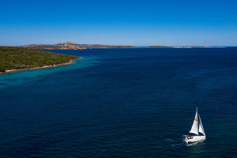 High angle view of sailboat in sea against sky