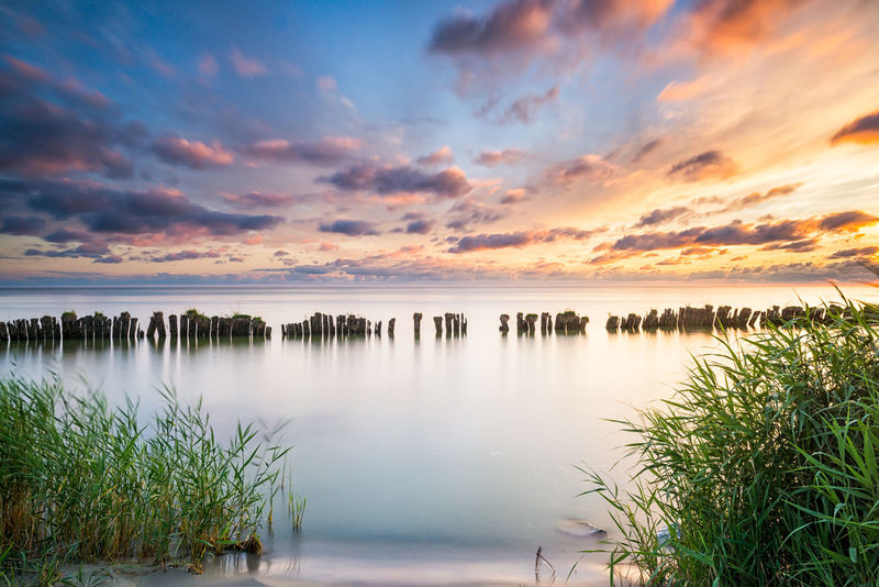Lake IJsselmeer EyeEmNewHere Orange Sky The Netherlands Beauty In Nature Blue Breakwater Clouds And Sky Day Horizon Over Water Ijsselmeer Lake Landscape Longexposure Nature No People Outdoors Reed Scenics Seascape Sky Sunset Tranquil Scene Tranquility Water