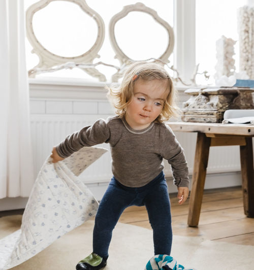 Cute Girl With Mat Walking At Home