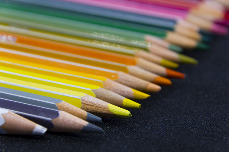 Close-Up Of Colored Pencils On Fabric
