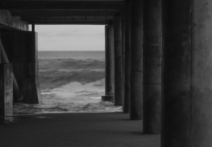 """""""Watery Frame"""" Photographed by AJTinker AjTinkerPhotography Sea Horizon Over Water Water Beach Architectural Column Scenics Nature Built Structure Day Architecture Beauty In Nature Underneath Indoors  No People Wave Sky EyeEm Gallery EyeEmSelect Tranquil Scene EyeEm Best Shots Black And White Black & White Black And White Friday"""