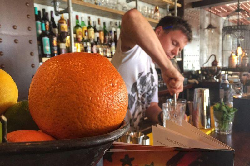 Cocktail making Cocktail Bartender Making Mixing Drinks Mixology Bar Man Backbar Fruit Muddling