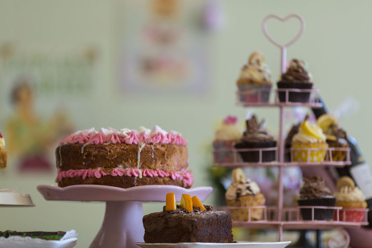 Close-Up Of Cakes On Stand Indoors