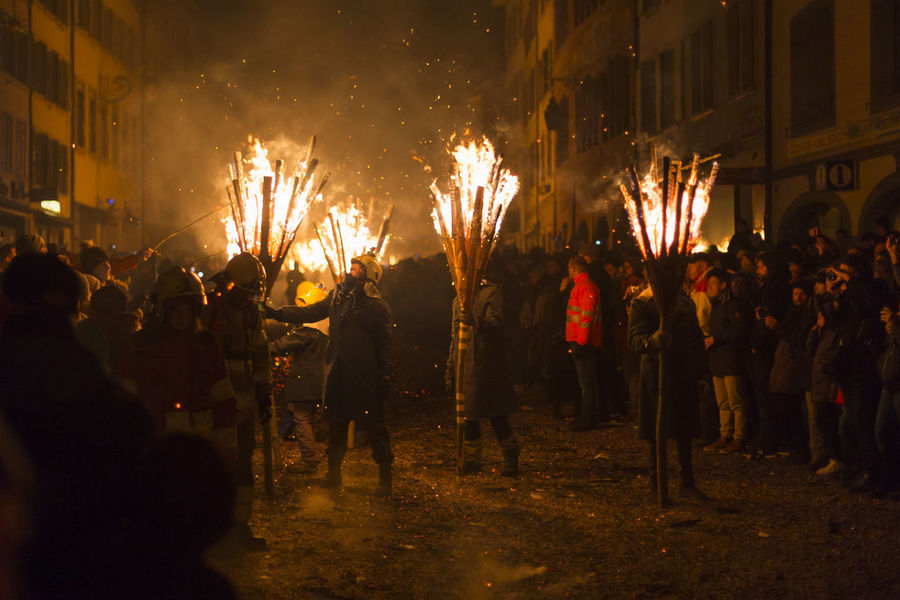 Chienbaese festival. Switzerland, Liestal, Rathausstrasse 25, 18th of February 2018. Festival participants carrying burning broom shaped wooden logs on their shoulders through the old town. Burning Event Flames Old Town Tradition Arts Culture And Entertainment Burning Celebration Culture Danger Event Fire Fire - Natural Phenomenon Flame Heat - Temperature Illuminated Liestal Night Parade Real People Smoke - Physical Structure Swiss Switzerland Travel Destinations Wood - Material