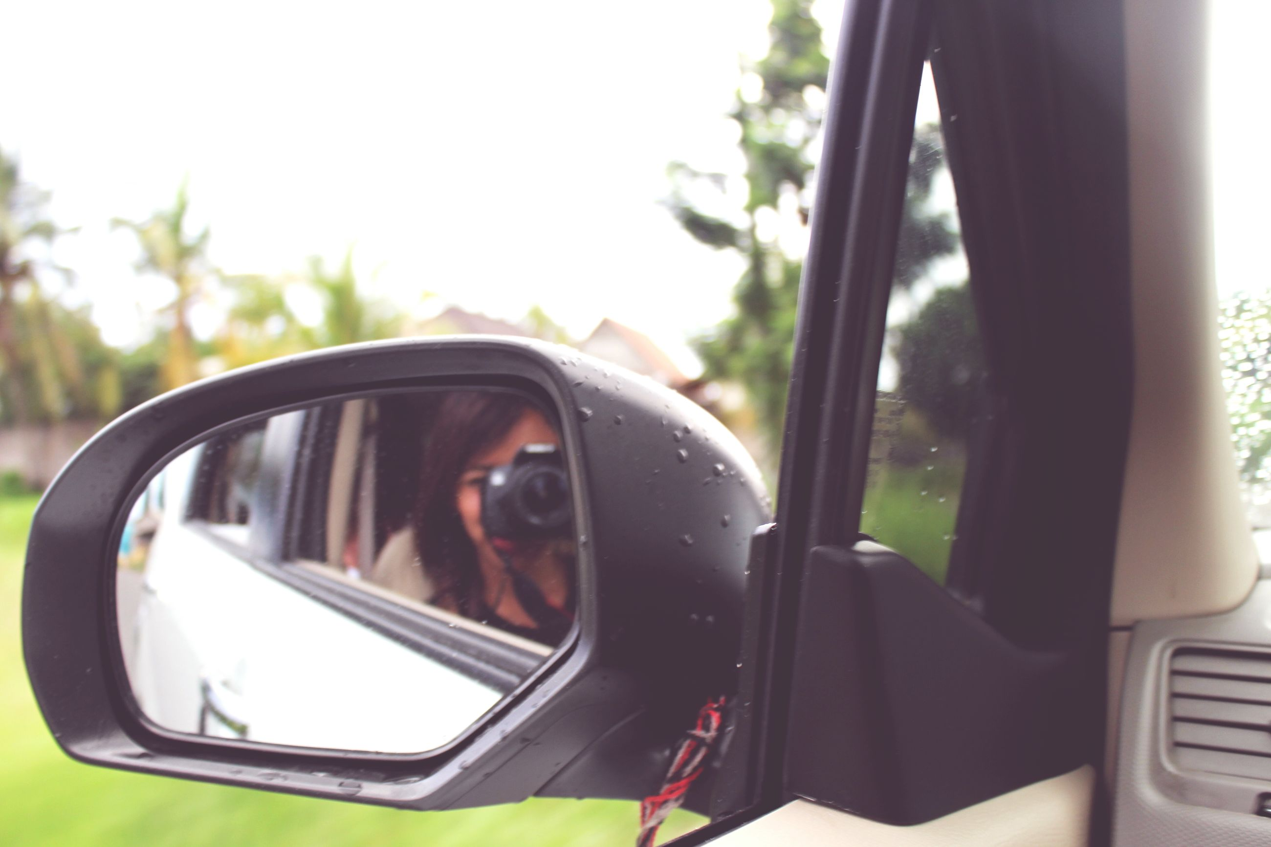 transportation, mode of transport, car, land vehicle, vehicle interior, side-view mirror, car interior, glass - material, reflection, transparent, close-up, window, part of, travel, windshield, rear-view mirror, steering wheel, cropped, driving, dashboard
