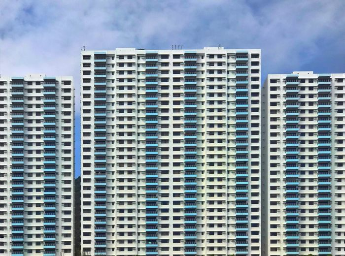 Housing estate in Hong Kong Architectural Feature Hong Kong Building Exterior Built Structure Architecture Cloud - Sky City Building Sky No People Residential District Day Tall - High Low Angle View Apartment Window Blue Outdoors Modern The Architect - 2019 EyeEm Awards