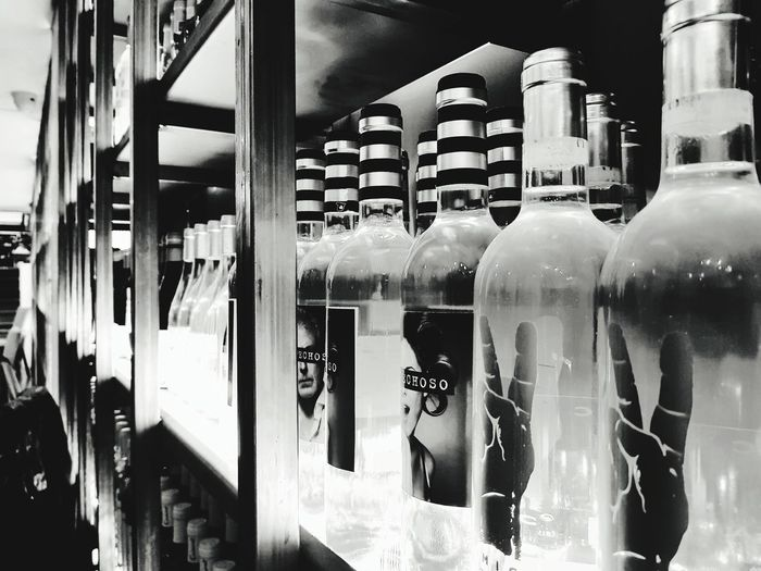 Close-up of wine bottles on display at store