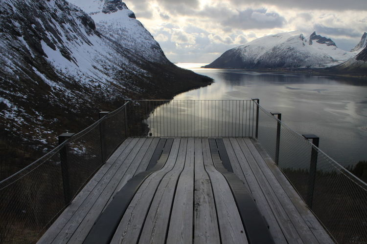 Magasuget, Senja Beauty In Nature Cold Temperature Day Lake Mountain Nature No People Outdoors Scenics Sky Snow Spectacular Tranquil Scene Tranquility Water Winter Wood - Material Wood Paneling Perspectives On Nature