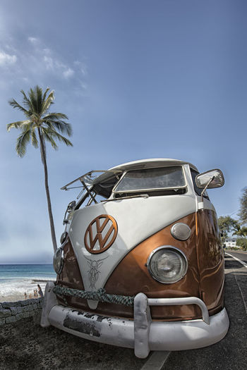 wide-lens photo of VW Microbus Bulli at beachside with palm tree in the background Bulli VW Beach Beachside Car Coconut Palm Tree Day Land Land Vehicle Luxury Microbus Mode Of Transportation Motor Vehicle Nature No People Outdoors Palm Tree Plant Retro Styled Sea Seaside Sky Surfing Transportation Tree Tropical Climate Vintage Car Water