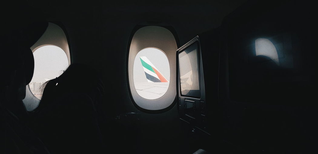 Mode Of Transportation Transportation Airplane Air Vehicle Travel Vehicle Interior Window Indoors  Public Transportation Journey Sunlight Glass - Material No People Day Close-up Land Vehicle Illuminated Flying Seat Looking Dark Airplane Seat