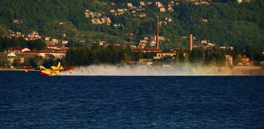 Water Outdoors Spraying No People Tree Day Nature Rainbow Arcobaleno  Canadair Lombardia, Italy Lago Di Como, Italy Sony A7RII Luca Riva Full Frame Sony A7rm2 Lago Tamron150600mm Tamron 150-600