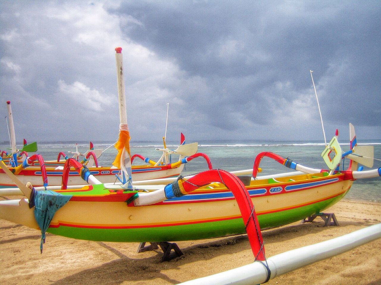 beach, sky, cloud - sky, sand, nautical vessel, sea, day, water, no people, moored, nature, outdoors, transportation, tranquility, horizon over water, beauty in nature, outrigger