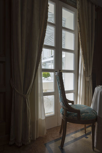 Chair and Window. Elégance Light Part Of Absence Architecture Armchair Chair Color Curtain Day Domestic Room Empty Furniture Home Home Interior Home Showcase Interior House Indoors  Luxury No People Relaxation Textile Window Window Light