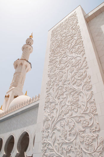 Low angle view of sheikh zayed mosque against sky