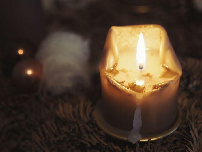 Close-up of illuminated tea light candle