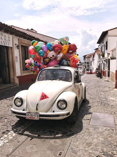 Let's get this party started. Mode Of Transport Car Land Vehicle Transportation Multi Colored Clown Party Time Party Party Taxi Public Transportation Taxi Original Town Life Lifestyles Humor Beetle Beetle Car Rethink Things Be. Ready. Rethink Things This Is Latin America Adventures In The City The Street Photographer - 2018 EyeEm Awards