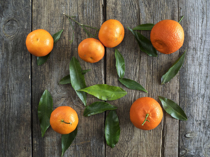 Directly Above Shot Of Oranges On Wooden Table