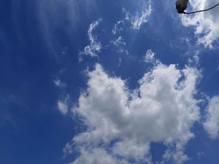 Low section of clouds in blue sky