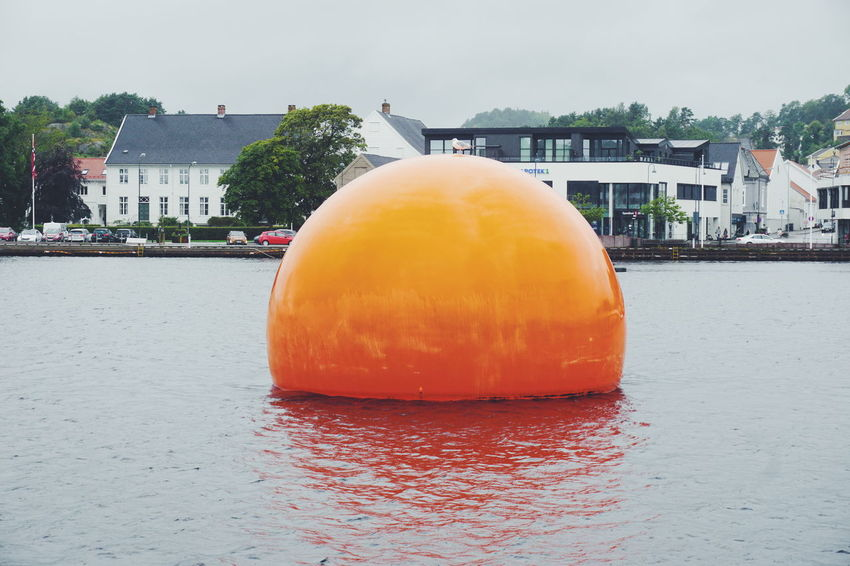 Mandal city Water Architecture Outdoors Building Exterior Built Structure No People Summer Beach Sky Day Politics And Government Visitnorway Mandal Norway Round Shape Orange Color Orange Beauty In Nature Southern Norway Sørlandet Modern Architecture Cold Temperature ArtWork