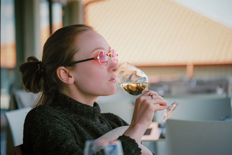 Restaurant Fujifilm 35mm Film 35mm EyeEmNewHere EyeEm Selects Food And Drink Child Indoors  Headshot Drink Childhood Drinking Side View Glasses Alcohol Portrait One Person Glass