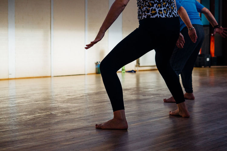 Low Section Dancing Indoors  Practicing Human Leg Wood Performance Hardwood Floor Lifestyles Human Body Part Flooring Women Arts Culture And Entertainment Real People Body Part Ballet Dancer Ballet Ballet Studio Adult Focus On Foreground Skill  Stage