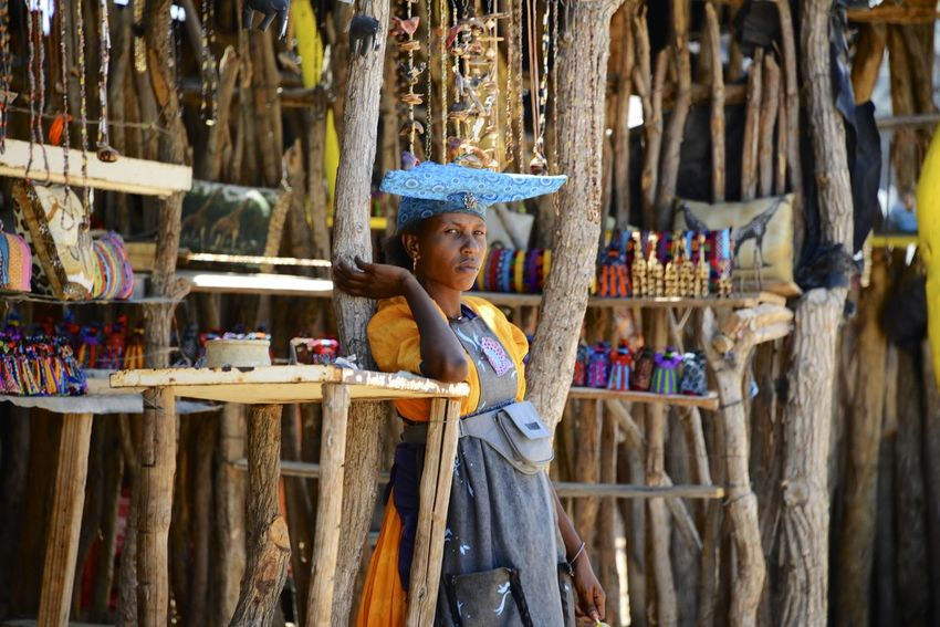 Herero women in Namibia Herero Tribe Namibia Souvenirs/Gift Shop Adult Africa Day Herero Lifestyles One Person Outdoors People Shop Side View Souvenir Souvenirs Tribe