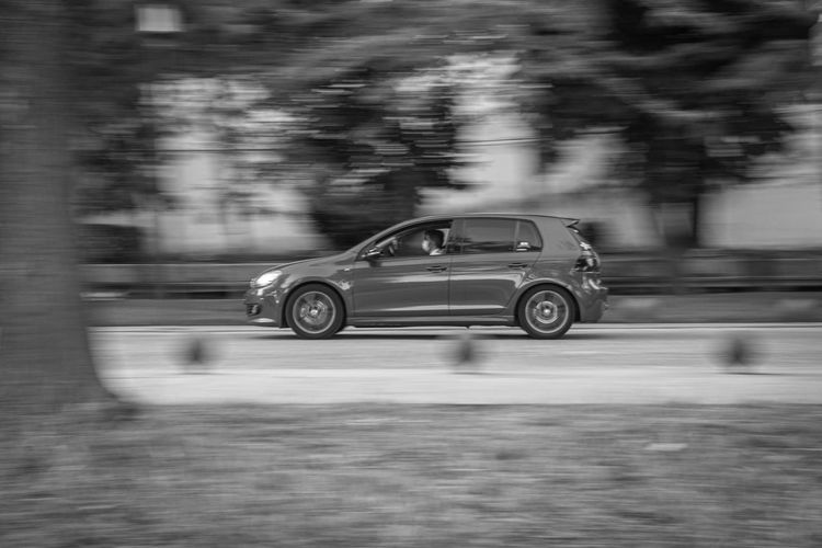 Blurred motion of car on road