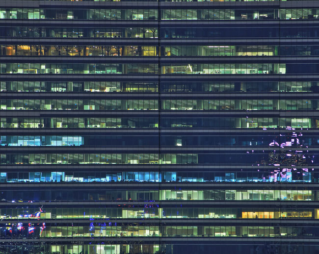 Multi-storey office building at night. late night at office. late night overtime in a modern office.