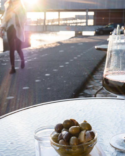 Food And Drink Food Freshness Table Day Wellbeing Olive Healthy Eating Sunlight Bowl Fruit Focus On Foreground Refreshment Green Olive Outdoors Plate Glass Real People Drink Container