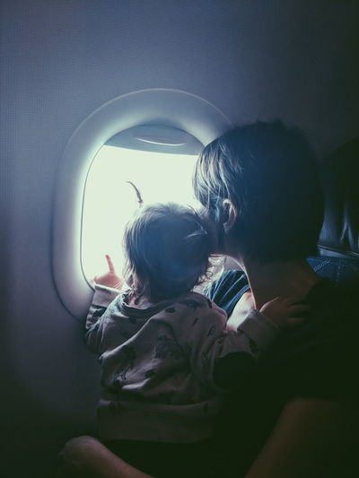 Mother and baby daughter looking out airplane window Window Silhouette Pair Looking Pointing Flying Air Travel  Mother Daughter Baby Babyhood Infant Airplane Airplaneview Travel Motherhood Discovery Child Togetherness Bonding Females Women Childhood Single Parent Toddler  Aircraft Commercial Airplane Airplane Wing Aeroplane