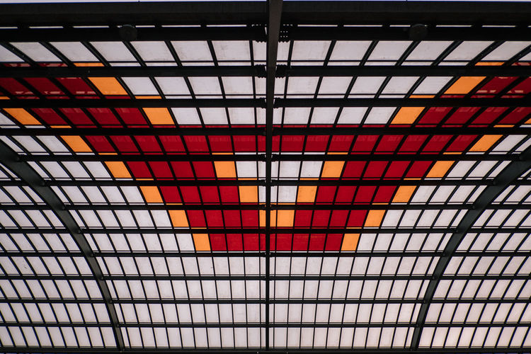 Ceiling Pattern Indoors  Architecture Low Angle View Built Structure No People Full Frame Modern Design Multi Colored Metal Transportation Glass - Material Geometric Shape Orange Color Shape Backgrounds Illuminated Architecture And Art