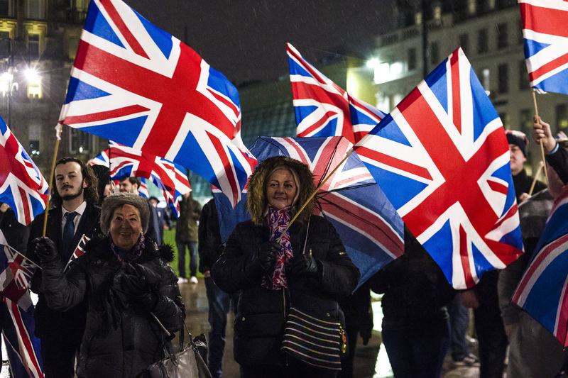Group of people walking in flags