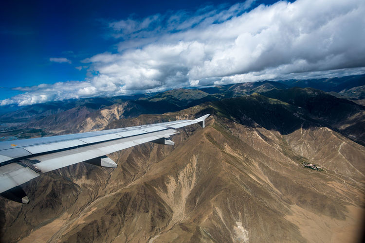 Viewing from Plane Cloud - Sky Air Vehicle Sky Airplane Mountain Environment Transportation Scenics - Nature Landscape Mode Of Transportation Nature Beauty In Nature Day Flying Mountain Range Travel Non-urban Scene Aerial View Aircraft Wing Land No People Outdoors Aerospace Industry